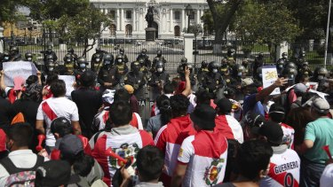 Protesters against the removal of President Martin Vizcarra gather in front of the Congress building in Lima, Peru.