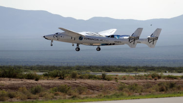Virgin Galactic founder Richard Branson and other crew members takes off from Spaceport America near Truth or Consequences, New Mexico.