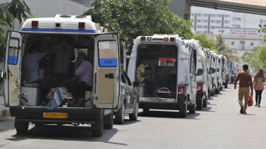 Ambulances line up waiting for their turn to deliver patients to a dedicated COVID-19 hospital in Ahmedabad, India.
