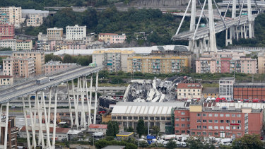 Cars stop on the Morandi highway bridge after a section of it collapsed on August 14, 2018.