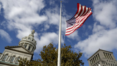 A United States flag is seeing flying at half staff.
