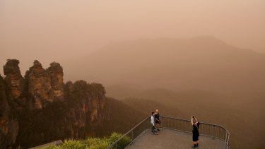 Tourists at the Three Sisters lookout in Katoomba last November as fire conditions  continued.