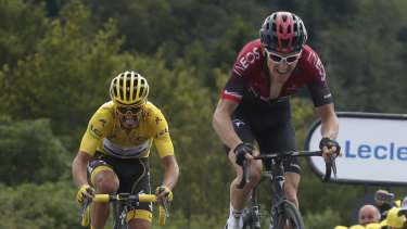 Grunt: Geraint Thomas powers away from leader Julian Alaphilippe in the stage six finale.