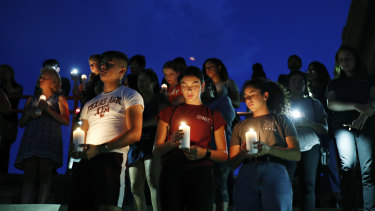 Mourners attend a vigil for victims of the deadly shooting that occurred earlier in the day at a shopping centre in El Paso, Texas.