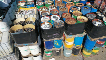 A stockpile of steel drums suspected to contain airbag detonators.