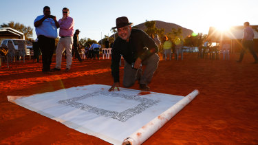 Noel Pearson signs the Uluru Statement from the Heart in May 2017.