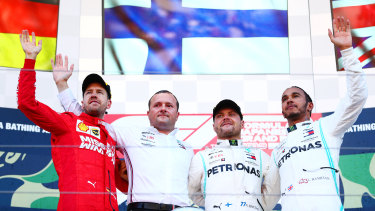Pride of place: Top three finishers Valtteri Bottas of Finland (second from right), Sebastian Vettel of Germany (far left), Lewis Hamilton of Great Britain (far right).