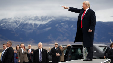 President Donald Trump arrives for a campaign rally at Bozeman Yellowstone International Airport.