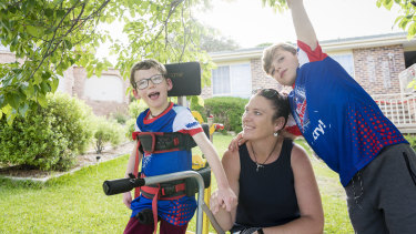 Seven-year-old Lucas Wallace, left, who is affected by cerebral palsy will participate in the Kids TRYathlon in February. By his side is mum Phyllis Wallace and nine-year-old brother Blake.