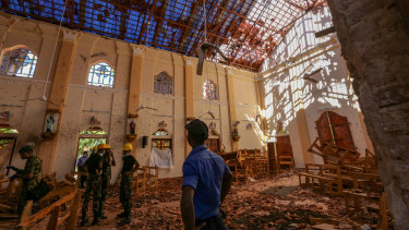 Soldiers inspect the damage inside St Sebastian's Church in Negombo, Sri Lanka.
