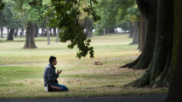 Uddin Mohammed, 31 prays in Hagley Park near he Al Noor Mosque.