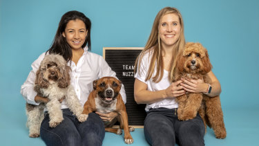 Nuzzl founder Erin Corcoran, left, and Erin Soll with Cali, Zara and Millie.
