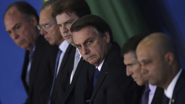 Brazil's President Jair Bolsonaro, centre, accompanied by his ministers, attends a ceremony to sign a decree on Regional Development last week.