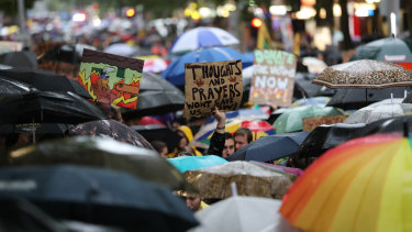 Climate change protesters marched through Melbourne, in defiance of a police request to postpone the rally.