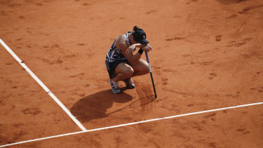 Australia's Ashleigh Barty reacts to winning her maiden grand slam at the French Open.