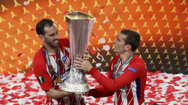 Best buds: Diego Godin and Antoine Griezmann lift the Europa League trophy.