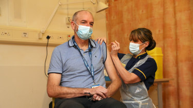 Professor Andrew Pollard, the director of the Oxford Vaccine Group, receives the jab given his status as a frontline health worker.