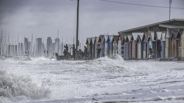 Waves lap at the Brighton Beach boxes during wild weather on Friday.