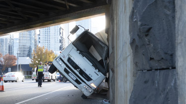 The truck hit the bridge on City Road, South Melbourne around 8.30am.