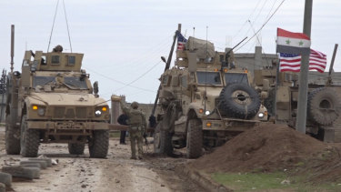 American military convoy is seen in the village of Khirbet Ammu, east of Qamishli city, Syria.
