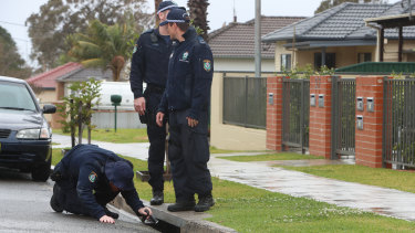 Police search for clues outside the house in which Kristie Powell was killed overnight.