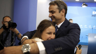 Greek opposition New Democracy conservative party leader Kyriakos Mitsotakis embraces his daughter Dafni after win in parliamentary elections.