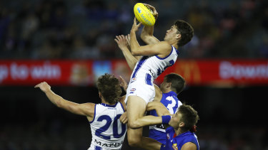 Hop to it: North Melbourne's Curtis Taylor flies high above the pack.