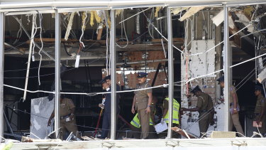 Police investigate the damage at the Shangri-La Hotel in Colombo.