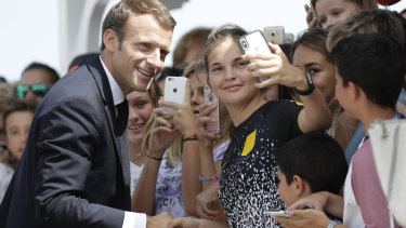 French President Emmanuel Macron shakes hands with wellwishers during a visit to the French Caribbean island of Saint Barthelemy last week.
