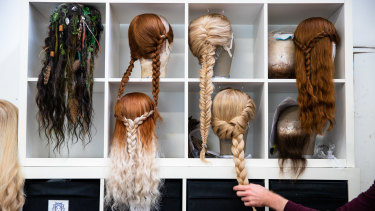 A collection of wigs and beards ready to go for Frozen the Musical.