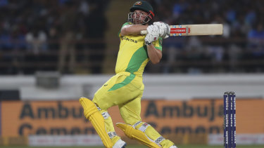 Aaron Finch goes over the top against India.