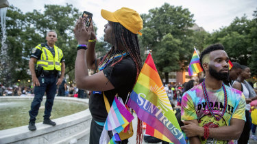 Police watch over the Pride parade in Washington, where a mass panic was sparked.