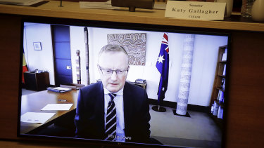 RBA governor Philip Lowe appears via video link during a Senate select committee hearing on COVID-19 at Parliament House.