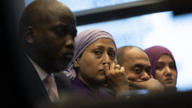 Representatives of the Rohingya community and The Gambia's Justice Minister Aboubacarr Tambadou, left, listen to testimony during a press conference in The Hague.