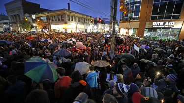 A crowd gathers at the intersection of Murray and Forbes avenues in the Squirrel Hill section of Pittsburgh during a memorial vigil for the victims of the shooting at the Tree of Life Synagogue where a shooter opened fire earlier in the day.
