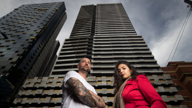 Neo200 tenants Nisha Mehrotra and Dion Aleksovski outside the fire-affected tower.