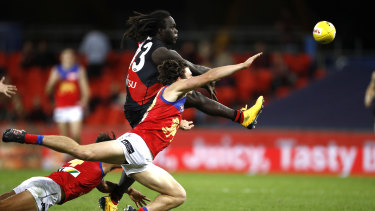 Tip top: Essendon's Anthony McDonald-Tipungwuti evades a smother to get a shot on goal.