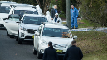 Police at the West Pennant Hills property where the two teenagers were killed.