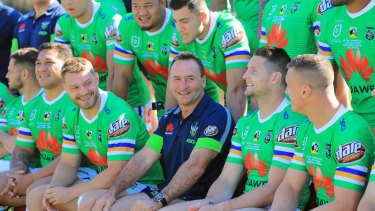 Raiders coach Ricky Stuart shares a laugh with his players.