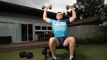 Waratahs prop Angus Bell works out in his backyard in Putney.