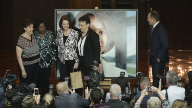 Former prime minister Julia Gillard poes for a photo with  Parliament House cleaners Anna Jancevski, Luzia Borges  and Maria Ljubic while Tony Abbott looks on.