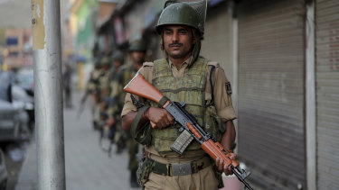 Indian soldiers patrol in Srinagar, India, on Sunday amid rising tensions.
