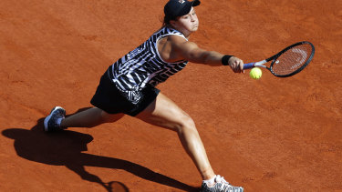 Barty stretches for the ball during the final of the French Open.