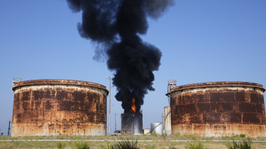 A column of smoke from a fire at an oil facility in southern Lebanon.