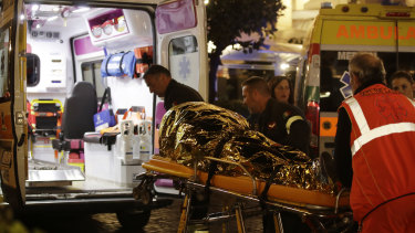 Rescuers evacuate a person who was injured after an escalator at a metro subway station in Rome sped up before crashing.