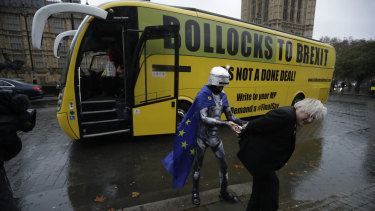 "A lookalike for pro-Brexit Member of Parliament Boris Johnson pretends to be arrested by a man dressed as RoboCop as an anti-Brexit ""Bollocks to Brexit"" campaign bus stands parked outside the Houses of Parliament in London on Friday."