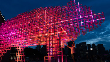 Chinese-Australian artist Qian Jian Hua beneath his pig lantern at the Sydney Opera House.