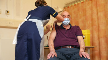 Brian Pinker, 82, receives the Oxford-AstraZeneca COVID-19 vaccine at the Churchill Hospital in Oxford.
