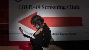 A woman waits outside a coronavirus testing station at Royal Melbourne Hospital on Thursday.