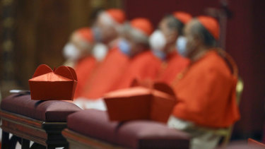 Cardinals sit as Pope Francis celebrates Mass last year at St Peter's Basilica.